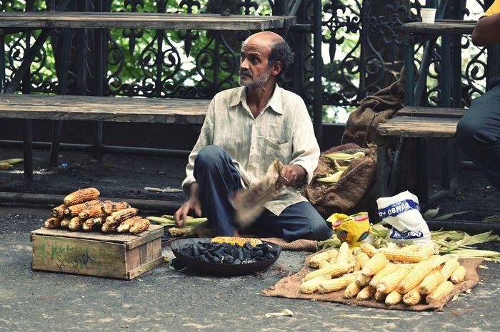 Corn Corn Seller Hardwork Streetphotography Sideways Roadside Seller Selling People Watching Working On The Way My View Long Walks