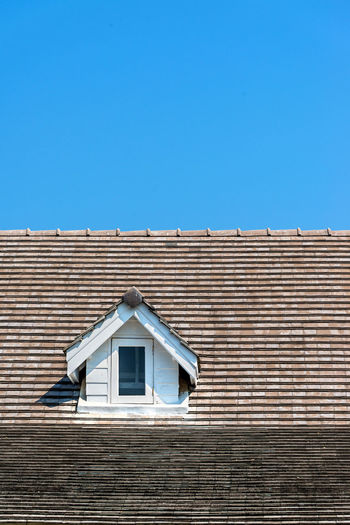 Low angle view of roof top against sky