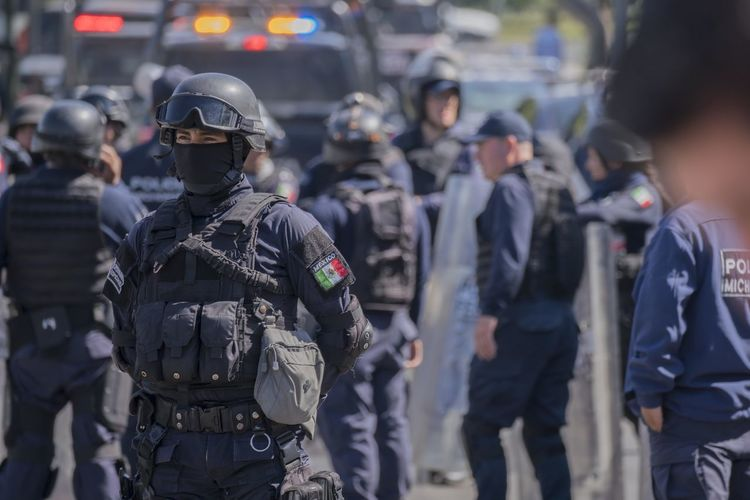 An anti-riot policeman stands during an operation. Anti-riot Police Authority City Clothing Day Focus On Foreground Government Group Of People Incidental People Law Men Occupation People Police Force Protection Real People Rear View Responsibility Safety Security Special Forces Standing Uniform