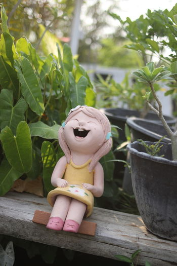 Stuffed toy on potted plant in yard