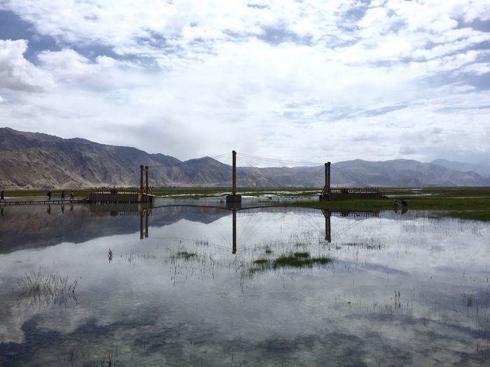Sky Cloud - Sky Water Reflection Beauty In Nature Tranquil Scene Tranquility Scenics - Nature Mountain Nature No People Lake Day Non-urban Scene Fence Boundary Barrier Outdoors Environment Wooden Post