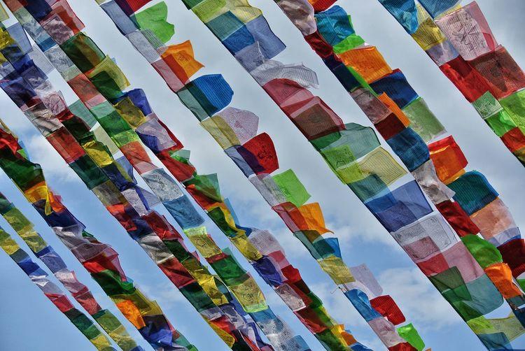 Full frame shot of multi colored umbrellas hanging in row