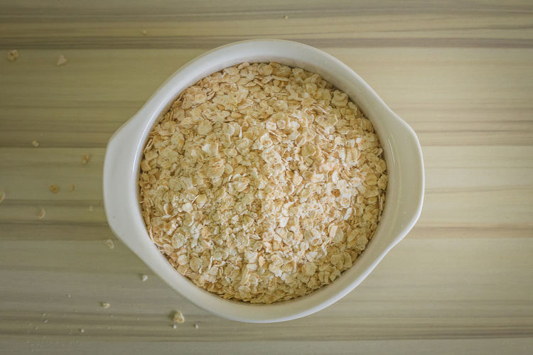 The oats rice in white bowl on top table wood worm tone image Cereal Diet Wood Bowl Dietfood Oat Oatmeal Oats Oats - Food Organic Organic Food Rolled Table White Wooden Wooden Texture