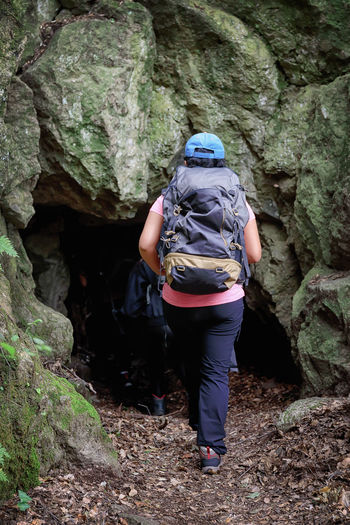 Rear View Full Length Of Woman Entering Cave