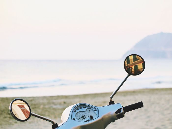 Sea Focus On Foreground Water Day Outdoors Close-up No People Sky Nature Beach Horizon Over Water Beauty In Nature Vespa Mirror Mirror Reflection Reflection Building Exterior Building Italy Alassio Vintage EyeEm Ready   AI Now Visual Creativity