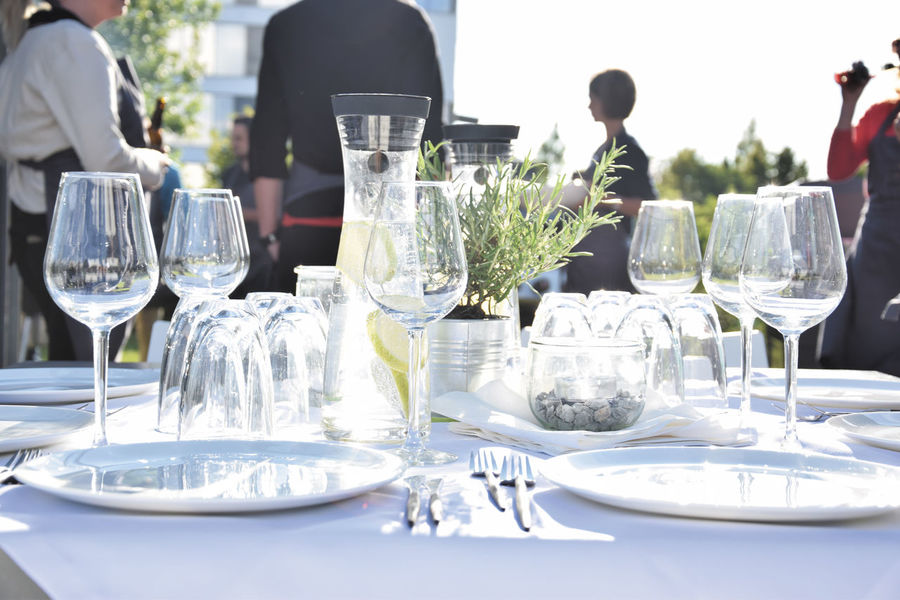 Celebration Day Dining Dining Table Dinner Dinner Party Drinking Glass Elégance Food And Drink Fork Garden Party Lunch Meal Napkin Outdoors Place Setting Plate Real People Restaurant Social Gathering Table Tablecloth Waiter Wine Wineglass