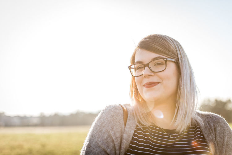 Glasses Eyeglasses  Portrait Sky One Person Young Adult Headshot Front View Real People Hairstyle Lifestyles Nature Hair Young Women Copy Space Sunlight Long Hair Clear Sky Outdoors Beautiful Woman Lens Flare Contemplation