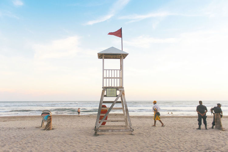 Beach México Adult Beach Beauty In Nature Child Day Flag Full Length Horizon Over Water Lifeguard  Lifeguard Hut Lifestyles Nature Outdoors People Pre-adolescent Child Real People Sand Sea Sky Togetherness Travel Destinations Water Young Adult