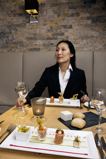 Mid adult woman sitting at table