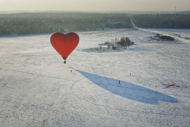 View of hot air balloon flying over land