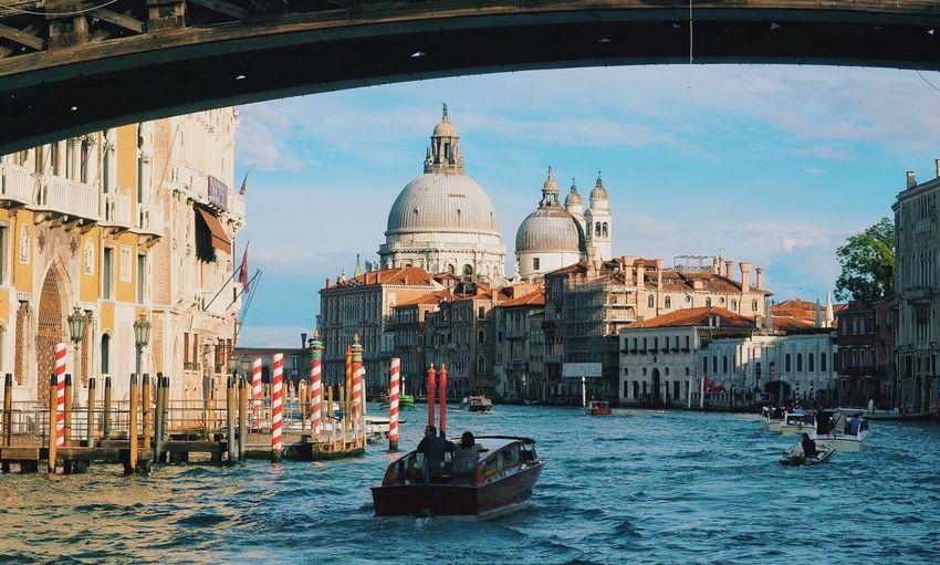 Boats in grand canal against santa maria della salute