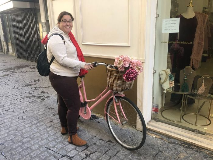 Paseo por las calles de Sevilla Real People Bicycle One Person Land Vehicle Transportation Building Exterior Moments Of Happiness Casual Clothing Built Structure Leisure Activity Women Architecture Adult Lifestyles Standing Winter Portrait Full Length Day Outdoors Females Moments Of Happiness