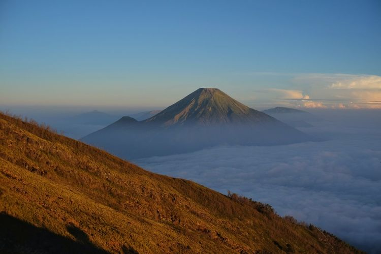 Mount sindoro seen from mount sumbing in morning where thick clouds still lay cover the view