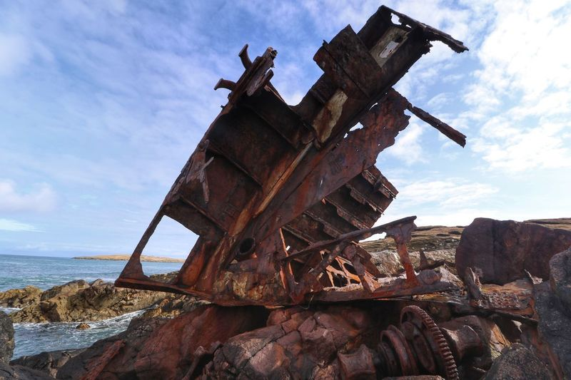 Shipwreck on the shore of Isle of Lewis Faded Beauty Rusty Metal Rust Never Sleeps Rust Portnaguron Isle Of Lewis Shipwrecked Shipwreck Beach Ship Shipwreck Scotland Cloud - Sky Sky Sea Day Outdoors No People Water Nature Oil Pump