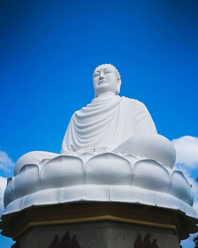 EyeEm Selects Sculpture Statue Place Of Worship Spirituality Blue Religion Sky Architecture Buddha