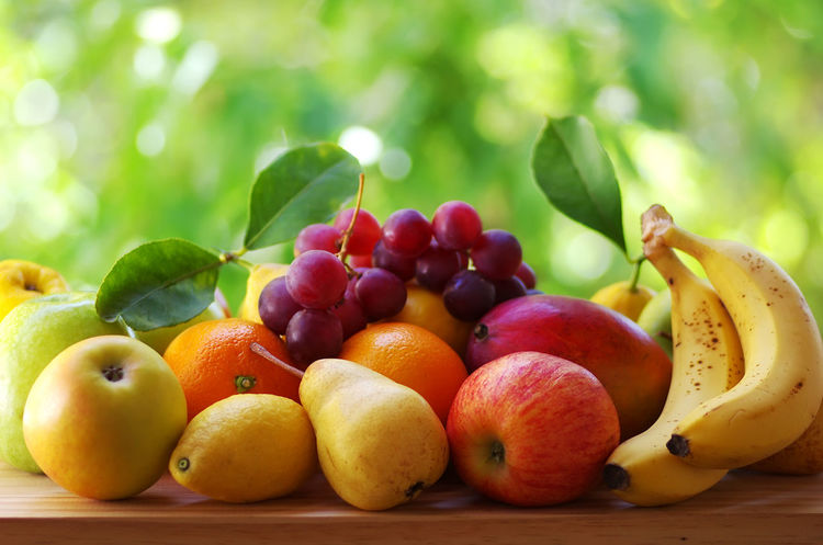 various fresh exotic fruit on table, green background Apple - Fruit Banana Close-up Food Food And Drink Freshness Fruit Grape Green Color Healthy Eating Leaf Ripe