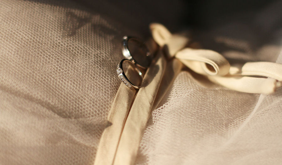 High Angle View Of Wedding Rings On Textile