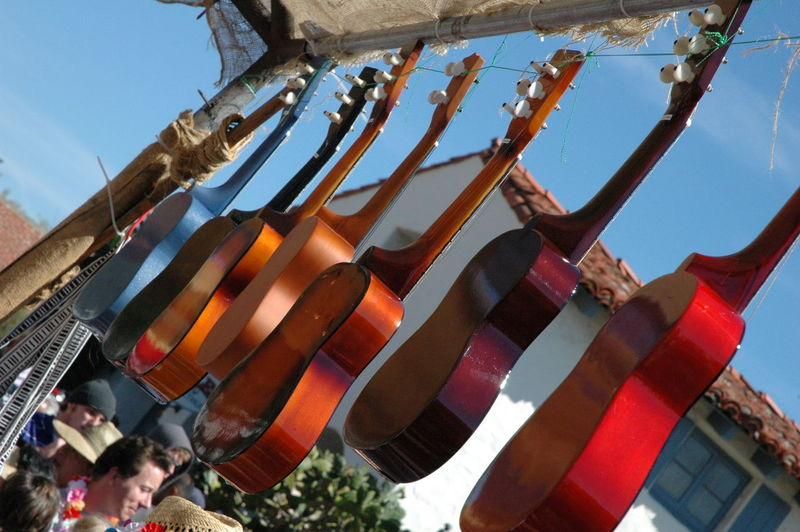 Lessons Music Day Entertainment Guitar Hanging Instrument Instruments Leisure Activity Low Angle View Music Lessons Music Tuning No People Outdoors Performance Play Selective Focus Sell Music Sky String Instrument Swap Meet Tuning Tuning Ukulele Ukulele Vendor
