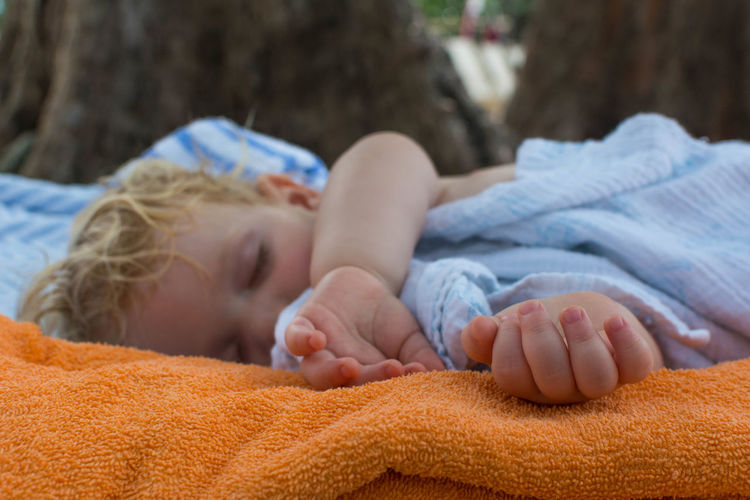 Close-up of baby sleeping outdoors