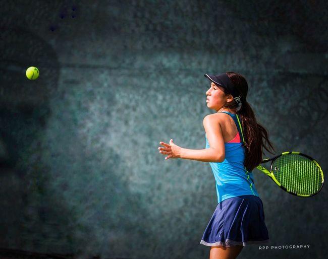 Juniors tennis player during the heat of the game setting up her shot. Tennis Intensity Girl Tennis Tennis Racket Tennis Ball One Person Motion Healthy Lifestyle Tennis 🎾 Tenniscourt Tennis Player Tennislife