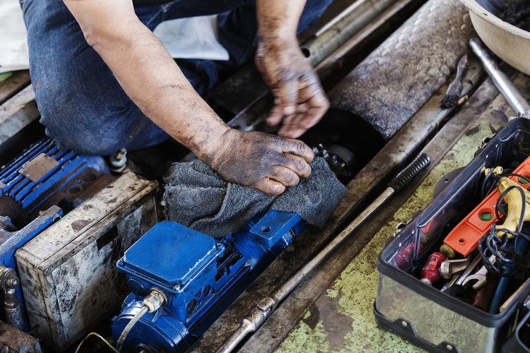 High angle view of man repairing machinery