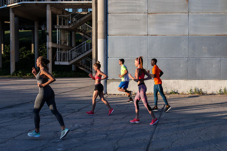 Group of people running in city
