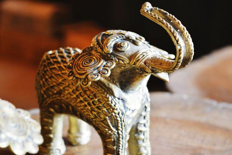 Close-up of brass elephant souvenir statue