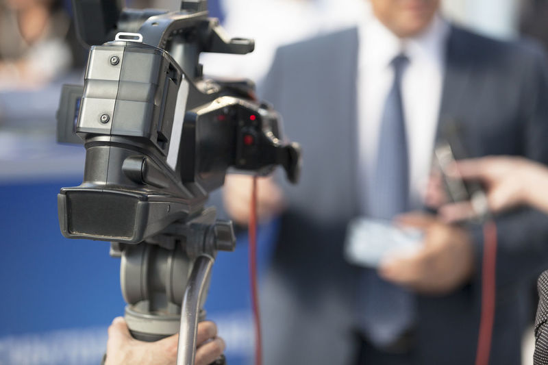 Cropped Image Of Journalist Filming Businessman