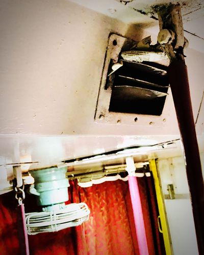 Air Conditioned Sleeper Train, newspaper stopping vibrating noise, quickfix Sleeper Train India Air Conditioner Quickfix No People Indoors  Low Angle View Hanging Close-up Day