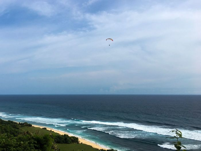 Paragliding over Nyang Nyang Beach. Exploring Explore Bali Uluwatu In The Sky Sport Bali Up High Adventure Sports Adventure Paragliding Over Beach Paragliding Paradise Sea Horizon Over Water Sky Water Nature Scenics Beauty In Nature Cloud - Sky Day Beach Wave Adventure Outdoors Tranquil Scene Tranquility Motion Vacations Extreme Sports EyeEm Ready   EyeEmNewHere