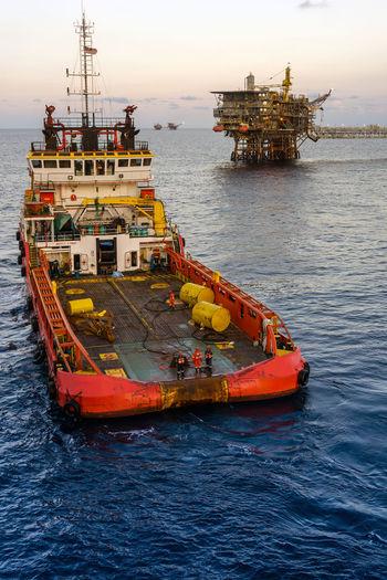anchor handling art oil field Offshore Offshore Life Safety Coverall Job Construction Oil Rig Occupation Rigging Anchor Buoy Anchor Handling Tug Boat Boat Ship Vessel Able Bodied Seamen Stern Platform Nautical Vessel Sea Water Offshore Platform Oil Crude Oil Ship Fossil Fuel Oil Industry