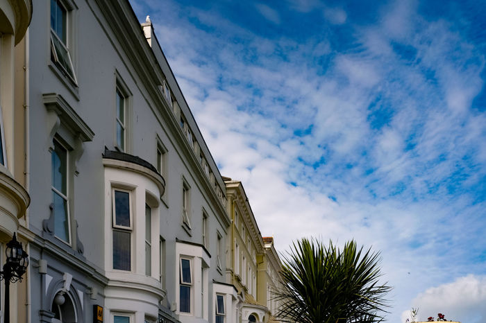 Llandudno, North Wales, on the Creuddyn peninsula. Cloudscape Creuddyn Peninsula Holiday Palm Tree Weather Architecture Bay Window Blue Building Exterior Built Structure Close-up Cloud - Sky Day Llandudno Low Angle View Nature No People North Wales Outdoors Palm Tree Sky Travel Destinations Tree The Week On EyeEm
