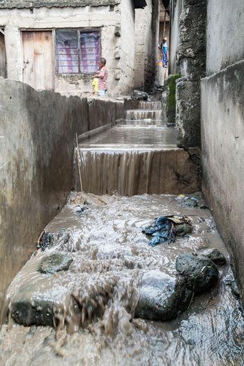Water flowing through rocks in building