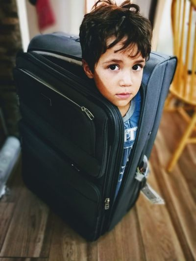 One Person Indoors  Childhood One Boy Only Child People Looking At Camera Sitting Suitcase Valise Lagguage Vacations Be. Ready.