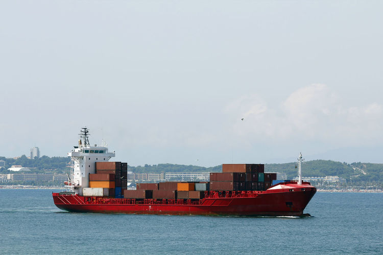 View of container ship in sea