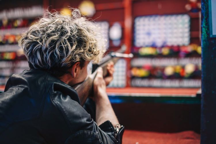 Boy with gun Fun Park One Person One Person Lifestyles Real People Men Adult Focus On Foreground