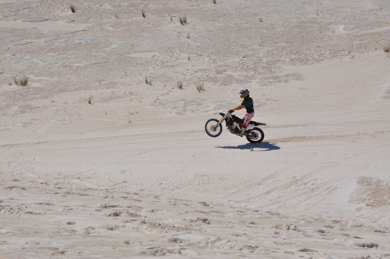 Off-road racing at the sand dunes in Lancelin, Western Australia. Adventure Day Extreme Sports Fun Lancelin Landscape Motion Motorbike Motorcycle Nature Off-Road Outdoors People Racing Recreational Pursuit Riding Sand Sand Dune Skill  Stunt Transportation Trick  Western Australia Wheelie White