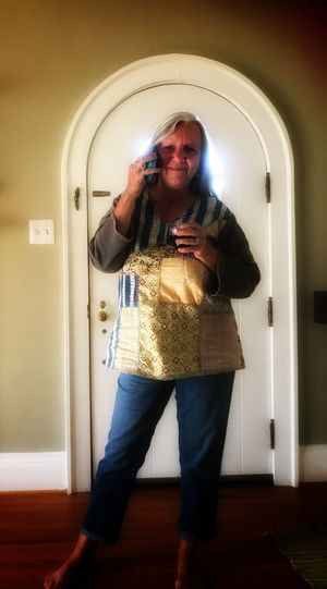 """Kathy relaxing at our apartment Happy To Be Out Of The """"cave"""" Apartment Talking On The Phone Her Best Friend One Person Technology Standing Front View Real People Wireless Technology Communication Mobile Phone"""