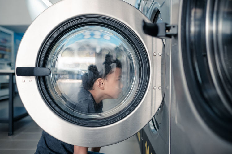 Boy looking at laundry in store