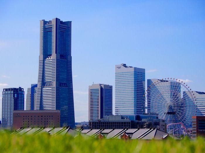 Yokohama Landmark Tower In City Against Sky