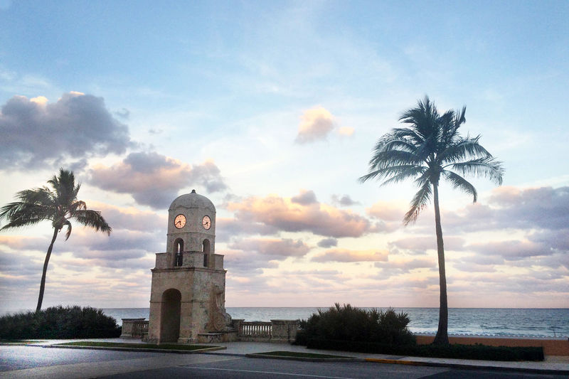 View of clock tower looking towards sea and beach Worth Avenue the main shopping street in Palm Beach Atmospheric Mood Cloud Cloud - Sky Cloudscape Cloudy Direction Dramatic Sky Dusk Guidance Light Moody Sky Orange Color Outdoors Sky Sun Sunset Worth Avenune