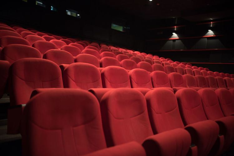 Close-up of empty chairs in auditorium