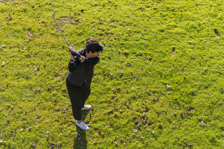 High angle view of man holding umbrella on field