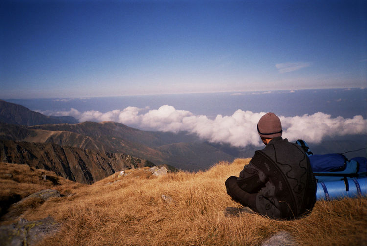 Admiring The View Beauty In Nature Cloud Fagaras Landscape People And Places Looking At View Film Photography Mountain Mountain Range Mountains Nature Negoiu Original Experiences Feel The Journey Over The Clouds Peak Rear View Remote Scenics Serbota The Great Outdoors - 2016 EyeEm Awards The Great Outdoors With Adobe Tranquil Scene The Following