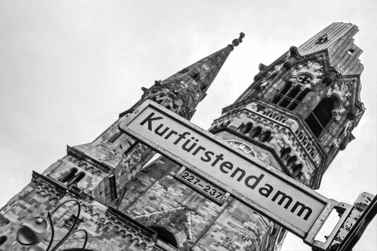 Berlin Photography Black & White Kaiser-Wilhelm-Gedächtnis Kirche Kudamm Architecture Berliner Ansichten Black And White Building Exterior Built Structure City Cloud - Sky Day Discover Berlin Famous Place Kaiserwilhelmgedächtniskirche Kurfürstendamm Low Angle View No People Outdoors Sky Street Sign Text