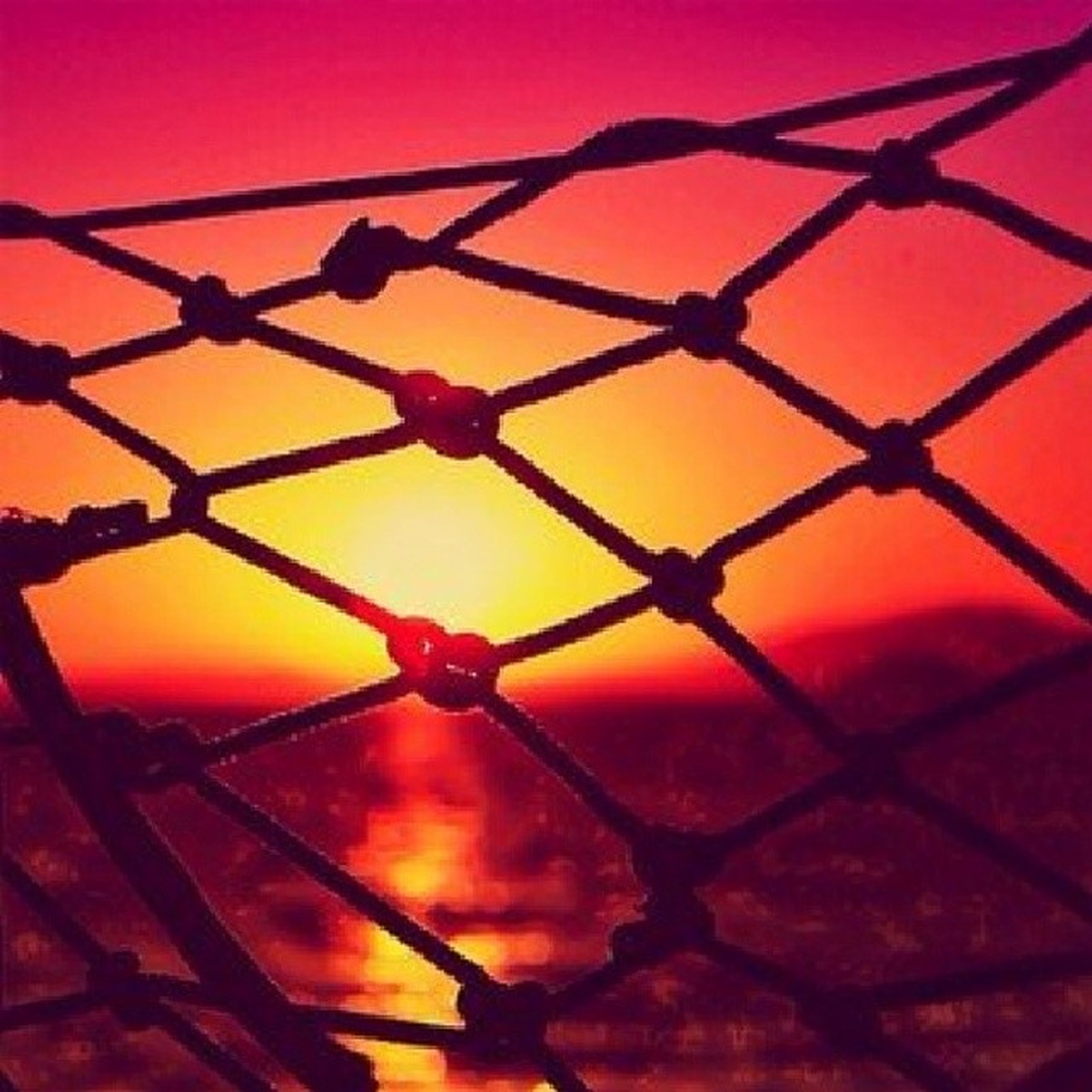 metal, protection, safety, sunset, orange color, chainlink fence, security, metallic, fence, sky, low angle view, pattern, red, sun, no people, close-up, outdoors, silhouette, sunlight, backgrounds