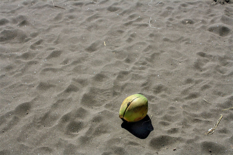 High angle view of ball on sandy beach