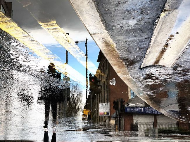 Adventures In The City Getting Inspired Lines Citylife Capital Cities  City Street Streetphotography Urban Visual Creativity Rainy Days Water Architecture Built Structure Building Exterior Nature Day Building Wet Sky Reflection Rain Sunlight Rainy Season