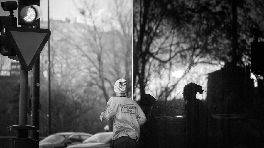 Portrait of senior man on road against trees