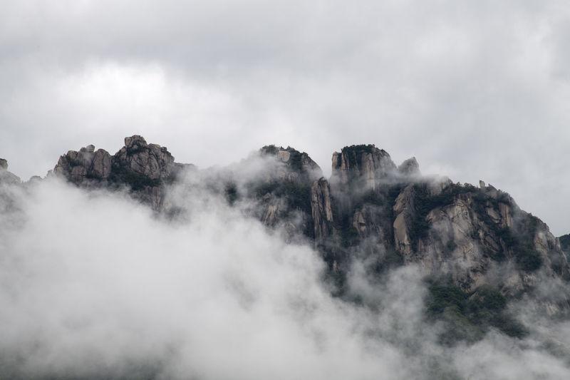 mountain and cloud at Ulsanbawi rocks of Seolak mountain in Gangwondo, South Korea Gangwondo Seolak Mountain Beauty In Nature Cloud - Sky Day Environment Landscape Mountain Mountain And Clouds Nature No People Non-urban Scene Outdoors Scenics - Nature Sky Tranquil Scene Tranquility Ulsanbawi